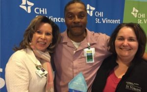Greg Long Receives Service Hero Award at Infirmary