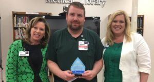 Charles Simmons Recognized as Service Hero at Infirmary