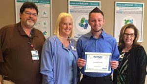 Casey Lovell Recognized as a Service Hero at the Infirmary