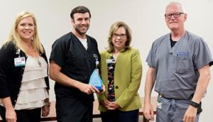 Dr. Garret Lewis Recognized as a Service Hero at Infirmary