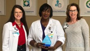 Linda Mullins Recognized as a Service Hero at Infirmary