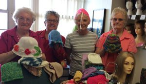 Knitting Group Donates Caps to New Outlook Cancer Recovery Program